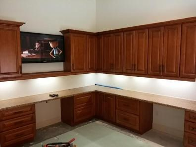 Cabinets installed w/ c/top, lighting and TV installed